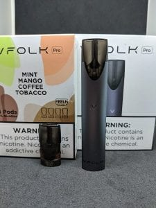 VFolk device and pod in front of boxes