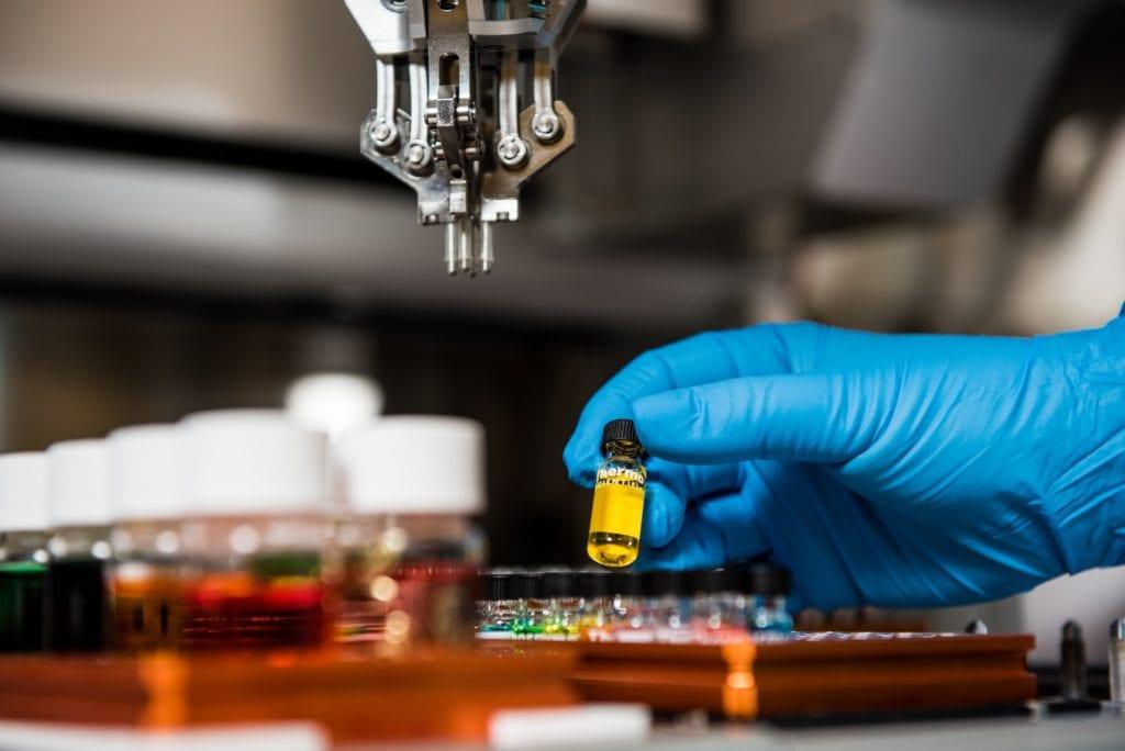 scientist holding vial